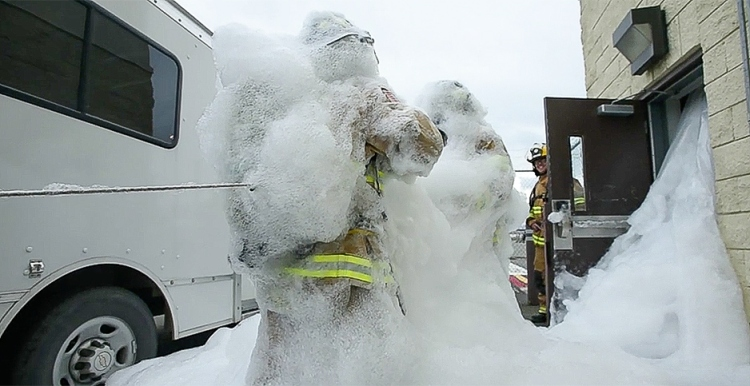 Firefighters covered in foam